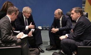 Boris Johnson et Vladimir Poutine lors de la conférence internationale sur la Libye, à Berlin, le 19 janvier 2020.