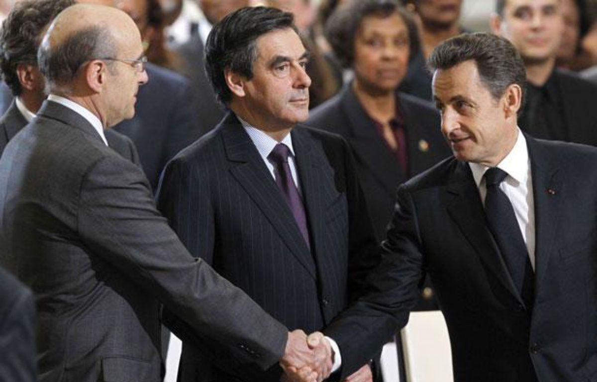 Alain Juppé, François Fillon et Nicolas Sarkozy lors de l'hommage àAimé Césaire, le 6 avril 2011. – Christophe Ena/AP/SIPA