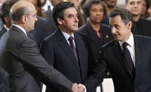 Alain Juppé, François Fillon et Nicolas Sarkozy lors de l'hommage àAimé Césaire, le 6 avril 2011.