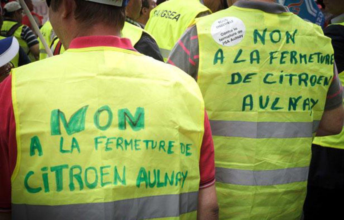 Manifestation de salariés devant le siège parisien de PSA Peugeot Citroën le 28 juin 2012. – GELEBART/20 MINUTES