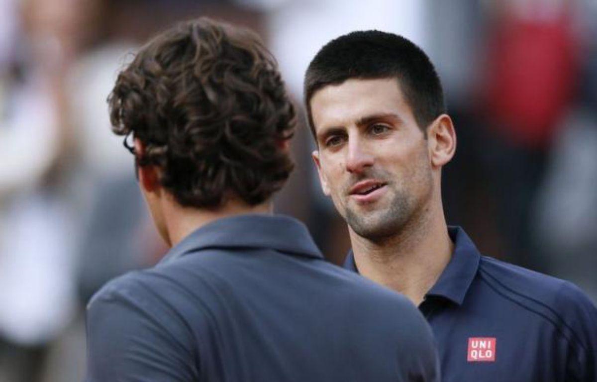 Novak Djokovic et Rafael Nadal ont rendez-vous lors d'une finale de Roland-Garros chargée d'histoire après avoir séché Roger Federer et David Ferrer en trois sets secs lors d'une journée humide vendredi. – Kenzo Tribouillard afp.com