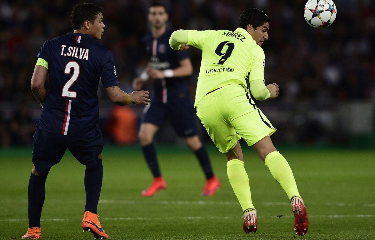 Le capitaine du PSG Thiago Silva contre le FC Barcelone, le 15 avril 2015, au Parc des Princes. – FRANCK FIFE / AFP