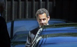 Nicolas Sarkozy le 2 juillet 2014 devant son domicile de Paris.