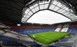 A picture taken on January 7, 2016 shows the tribunes and pitch inside Olympique Lyonnais football club's new stadium, Grand Stade de Lyon, in Decines-Charpieu, near Lyon, central-eastern France.   / AFP / PHILIPPE DESMAZES