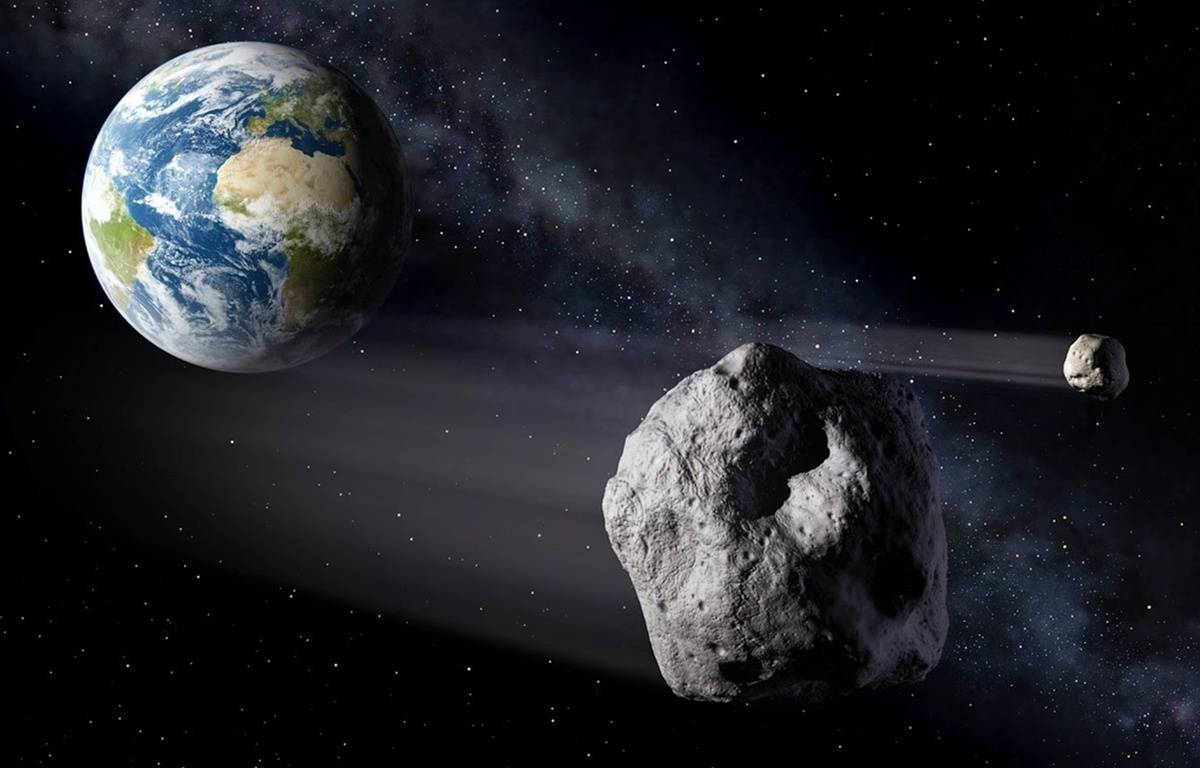 Vue d'artiste d'un astéroïde passant à proximité de la Terre. – P.CARILL/ESA