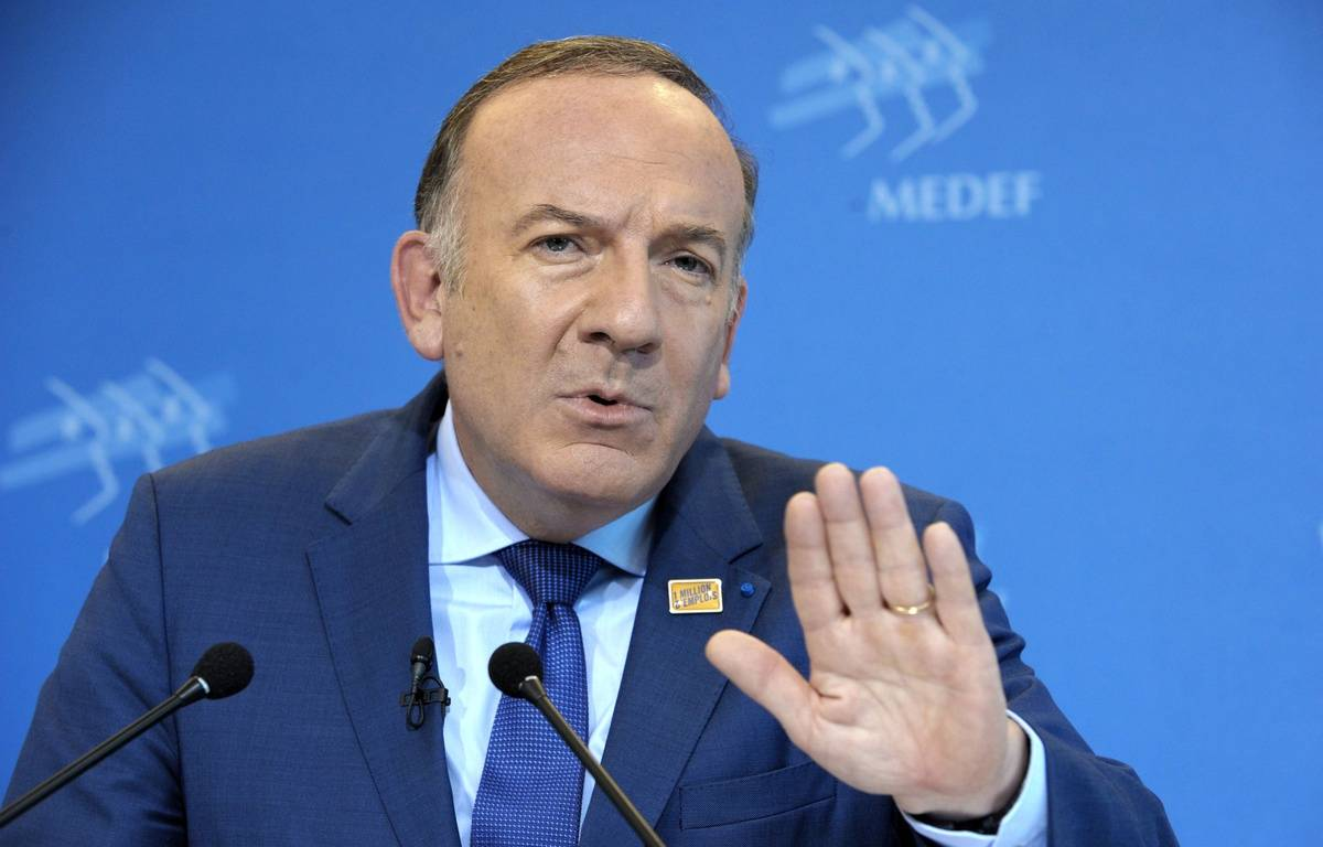 French employers' association Medef's head Pierre Gattaz talks during his monthly press conference on October 14, 2014 at the Medef headquarters in Paris. AFP PHOTO / ERIC PIERMONT – AFP