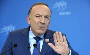 French employers' association Medef's head Pierre Gattaz talks during his monthly press conference on October 14, 2014 at the Medef headquarters in Paris. AFP PHOTO / ERIC PIERMONT