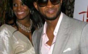 Le chanteur Usher et sa compagne Tameka Foster.