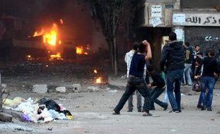 Heurts entre policiers et partisans des Frères musulmans, le 17 janvier 2014 au Caire