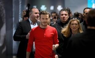 Le footballeur David Beckham lors d'une séance de dédicace dans le magasin H&M de Paris le 24 mai 2013.