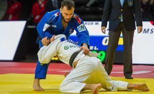 Luka Mkheidze (de face) lors du Grand Slam de Paris en février 2020.