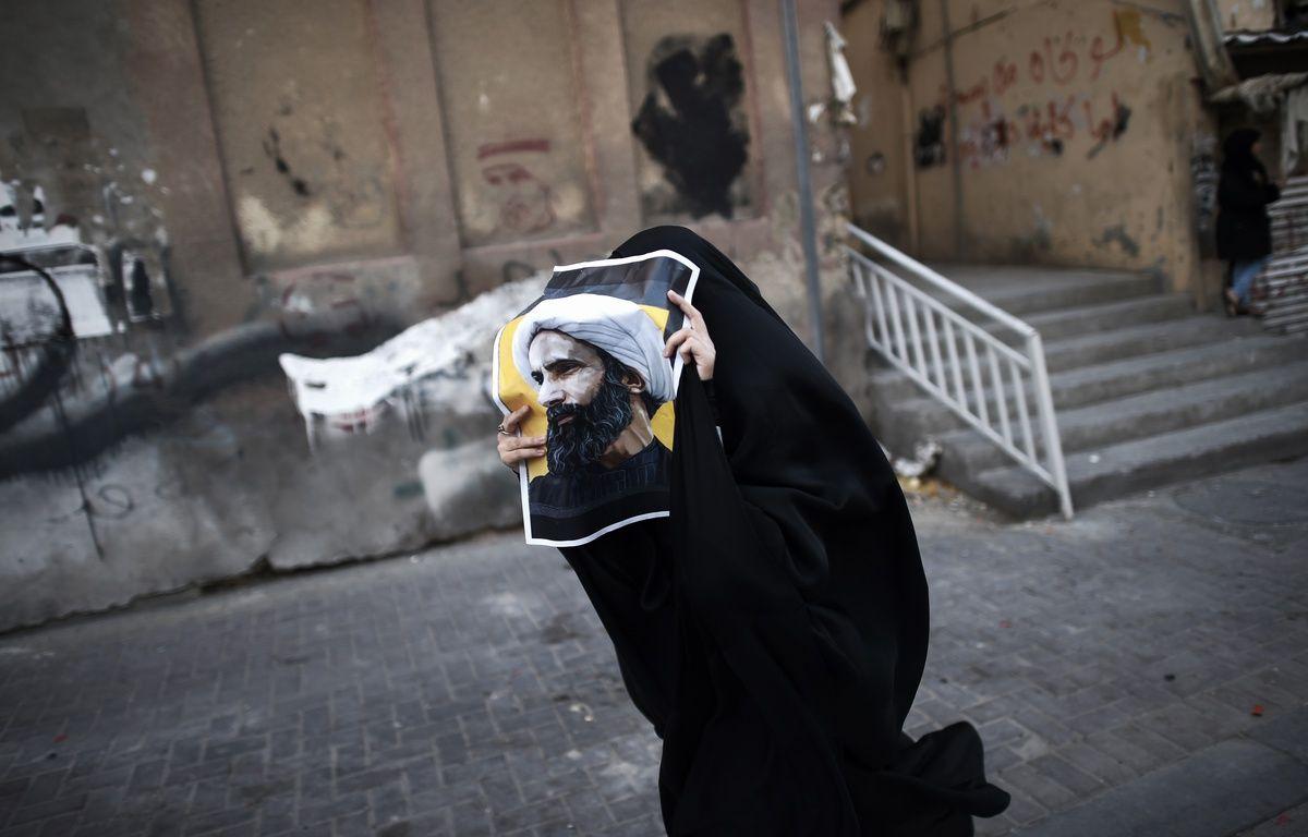 Une femme manifeste à Bahreïn après l'exécution du cheikh Nimr Baqer al-Nimr le 2 janvier. – MOHAMMED AL-SHAIKH / AFP