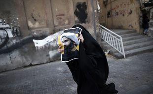 Une femme manifeste à Bahreïn après l'exécution du cheikh Nimr Baqer al-Nimr le 2 janvier.