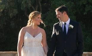 Amy Schumer et son mari, Chris Fisher.
