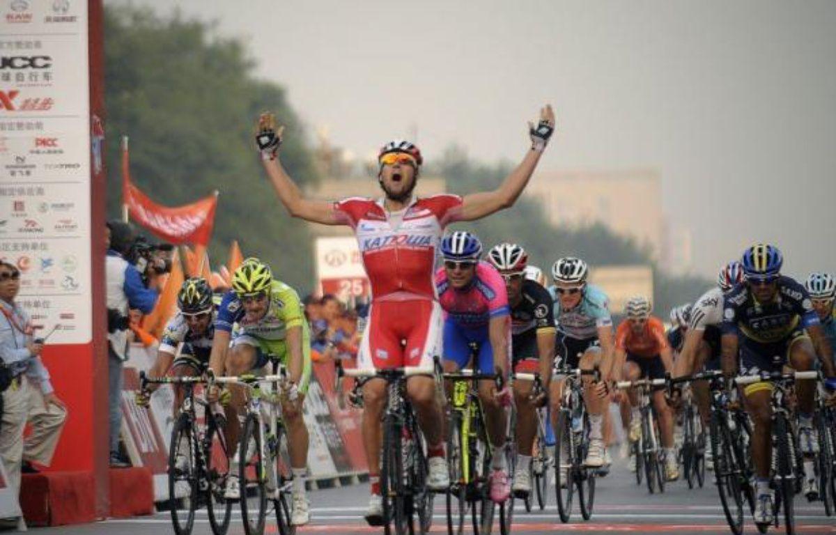 L'Autrichien Marco Haller (Katusha) a gagné vendredi au sprint la 4e et avant-dernière du Tour de Pékin cycliste, 165,5 km entre Yangping et Chang Ping, l'Allemand Tony Martin, tenant du titre et vainqueur de la 2e étape, conservant sa place de leader. – Wang Zhao afp.com