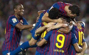 Les joueurs du FCBarcelone célèbrent un but contre Villareal, le 29 août 2011, au Camp Nou.
