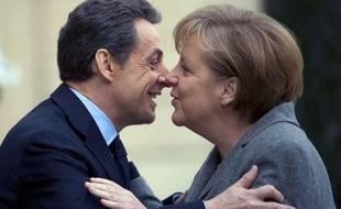 L'Allemagne en campagne 310x190_lnicolas-sarkozy-embrasse-chanceliere-allemande-angela-merkel-arrivee-elysee-6-fevrier-2012-paris