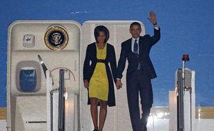 Barack et Michelle Obama à leur arrivée à Stansted Airport, le 31 mars 2009 dans le sud de l'Angleterre.