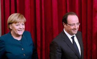 La chancelière allemande Angela Merkel et le président français François Hollande, le 18 décembre 2013 à l'Elysée, à Paris