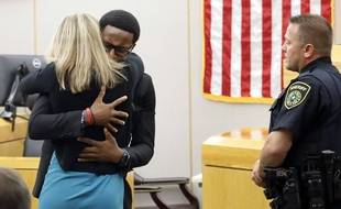Brandt Jean hugs Amber Guyger, the ex-policewoman sentenced to 10 years in prison on October 2, 2019, in Dallas for the murder of her brother Botham.