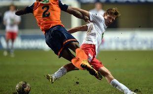 Clément Chantôme à la lutte avec Bryan Dabo lors de la rencontre entre le PSG et Montpellier le 5 janvier 2015.