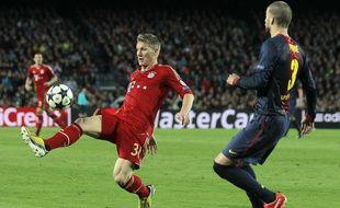 Bastian Schweinsteiger face à Gerard Pique lors du Barcelone-Bayern de mai 2013.