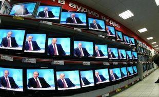 """""""Crédit express, en une heure"""": alléchés par ce type d'annonces omniprésentes dans les rues de Moscou, comme par les offres des grandes banques, les Russes accumulent les prêts à des taux parfois extravagants"""