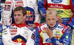 Sébastien Loeb et le Finlandais Mikko Hirvonen, ici au Portugal en mai 2010, sont coéquipiers dans l'écurie Citroën Rallye en 2012.