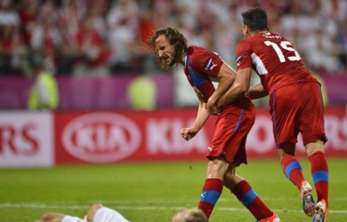 La République Tchèque a fait pleurer toute la Pologne en la battant logiquement (1-0) lors de la 3e et dernière journée du groupe A, et s'est qualifiée pour les quarts de finale de l'Euro-2012, samedi à Wroclaw. – Fabrice Coffrini afp.com