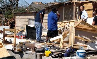 Barack Obama, le 29 avril 2011 dans l'Alabama, ravagé par des tornades.