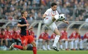 Lyon a remporté la 90e Coupe de France de football en battant le Paris SG 1-0 a.p., samedi au Stade de France, et réussi son premier doublé Coupe-Championnat.