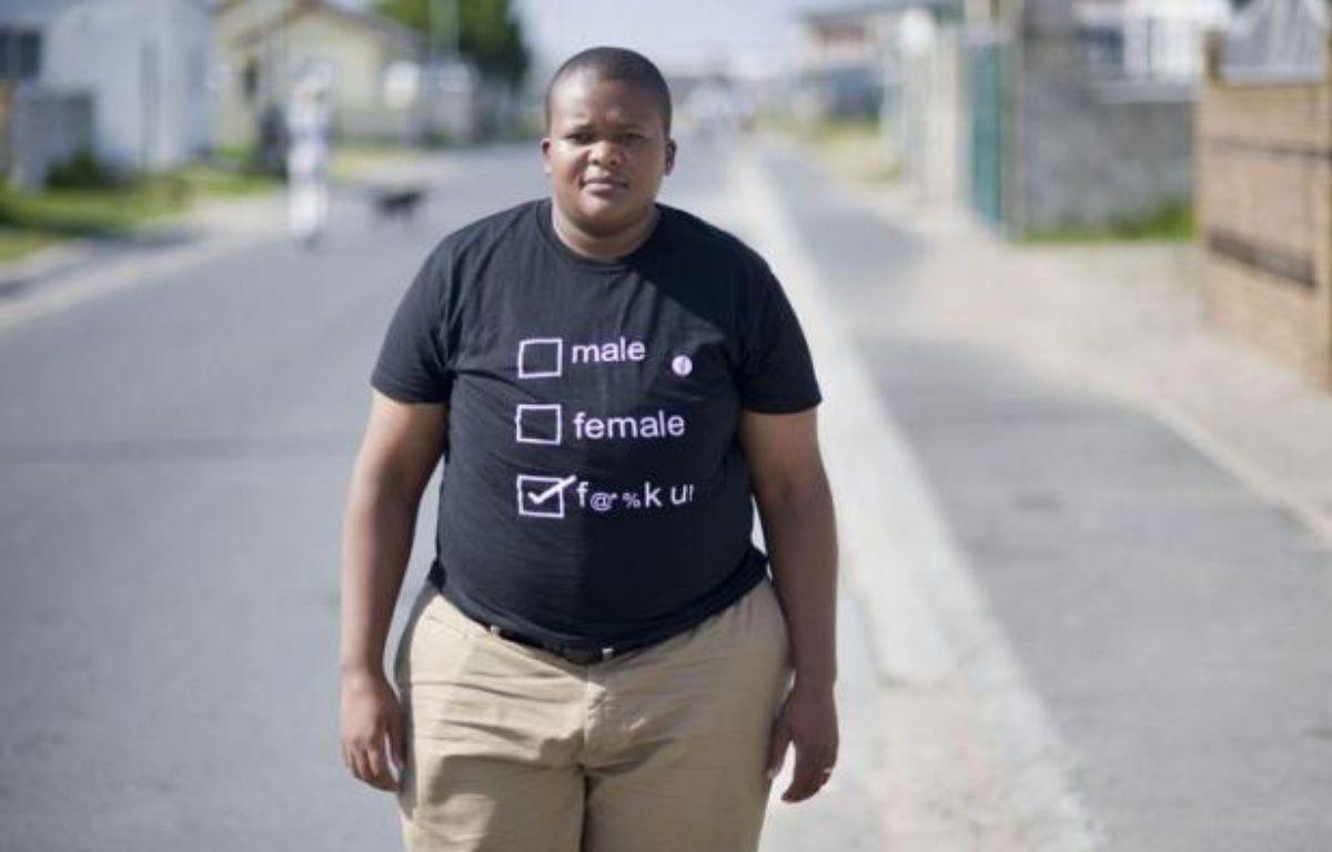 """Likamva Cekiso était encore adolescente quand elle a été violée. Comme de nombreuses lesbiennes des townships sud-africaines, elle a été victime de """"viols correctifs"""", destinés à la convertir à une hétérosexualité jugée plus orthodoxe. – Rodger Bosch afp.com"""
