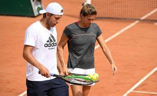 Lucas Pouille à l'entraînement avec Amélie Mauresmo, le 22 mai 2019 à Paris.