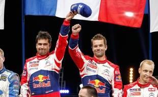 Daniel Elena et Sébastien Loeb sur le podium du Zénith de Strasbourg après leur victoire au Rallye de France 2012 et leur neuvième titre mondial.