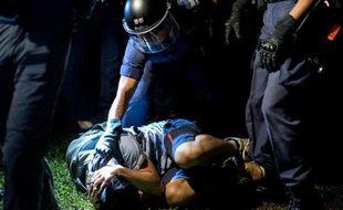 Des manifestants prodémocratie arrêtés à Hong Kong le 15 octobre 2014