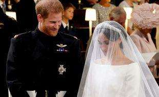 Harry et Meghan se sont parlé à l'arrivée devant l'autel de la mariée, le 19 mai 2018, à Windsor.