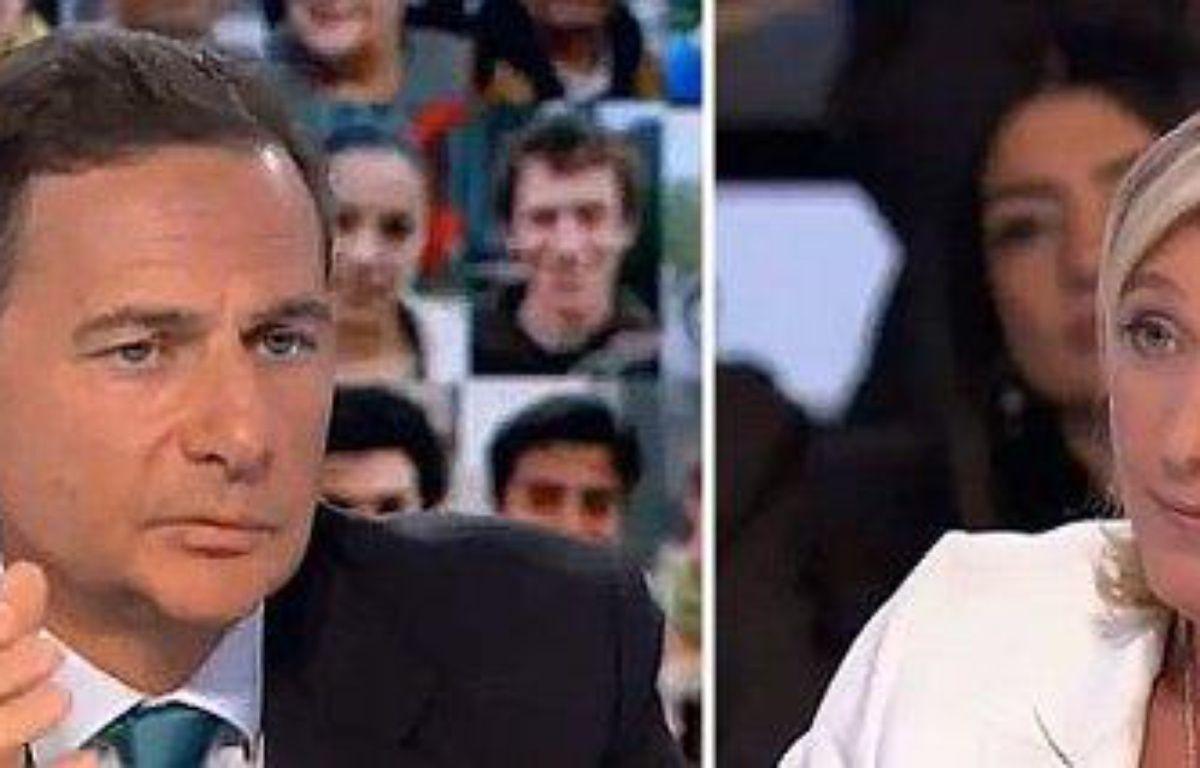 Le ministre de l'immigration, Eric Besson, et la vice-présidente du front national, Marine Le Pen – DR