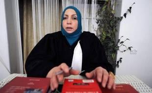 L'avocate algérienne du père de Mohamed Merah, auteur de sept assassinats en France, a déclaré lundi qu'elle se rendrait le 12 juillet en France pour remettre à la justice française des preuves en sa possession, dont des vidéos qui auraient été filmées par le tueur.