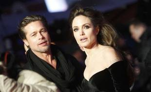 """U.S. actors Angelina Jolie, right, and Brad Pitt arrive at the European premier of the movie """"The Tourist"""" in Berlin on Tuesday, Dec. 14, 2010. (AP Photo/Markus Schreiber)/Germany_Film_Premier_The_Tourist_MSC109/1012142008"""