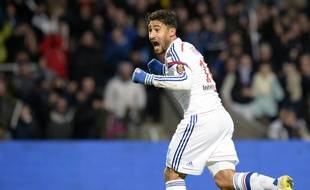 Lyon's French forward Nabil Fekir celebrates after scoring a goal during the French L1 football match Lyon (OL) vs Nantes (FCN) on February 22, 2015, at the Gerland stadium in Lyon. AFP PHOTO / JEAN-PHILIPPE KSIAZEK
