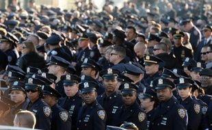 Des policiers le 27 décembre 2014 à New York aux funérailles de l'officier de police Rafael Ramos, assassiné en pleine rue à Brooklyn