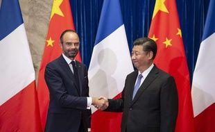 Edouard Philippe et le président chinois Xi Jinping à Pékin, le 25 juin 2018.