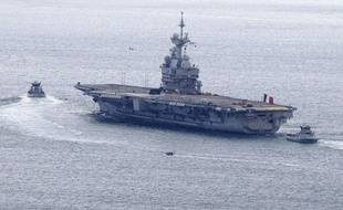 Le porte-avions français «Charles-de-Gaulle» quitte son port d'attache de Toulon, le 20 mars 2011.
