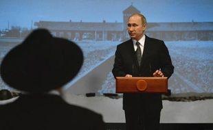 Le président russe Vladimir Poutine lors d'une cérémonie à Moscou au musée du Judaïsme pour le 70e anniversaire de la libération du camp d'Auschwitz, le 27 janvier 2015