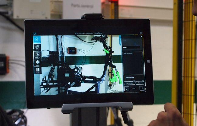 L'écran affiche les parties du scooter à vérifier.