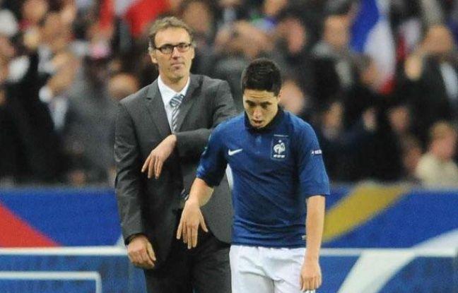 Samir Nasri et Laurent Blanc lors du match face à la Bosnie-Herzégovine, le 12 octobre 2011 au Stade de France.