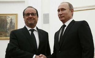 Les présidents français François Hollande et russe Vladimir Poutine, le 26 novembre 2015 à Moscou.