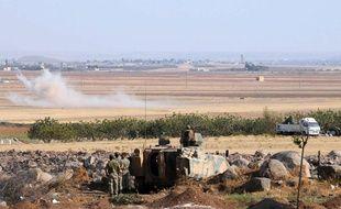 Fumées à la frontière entre la Syrie et la Turquie, le 22 août 2014.