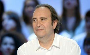 """Le patron d'Iliad et copropriétaire du journal Le Monde, Xavier Niel, invité du """"Grand Journal"""" sur Canal plus, le 25 juin 2015 à Paris"""