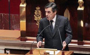 Le Premier ministre François Fillon s'exprime à l'Assemblée avant le débat et le vote sur l'intervention française en Libye, le 12 juillet 2011.